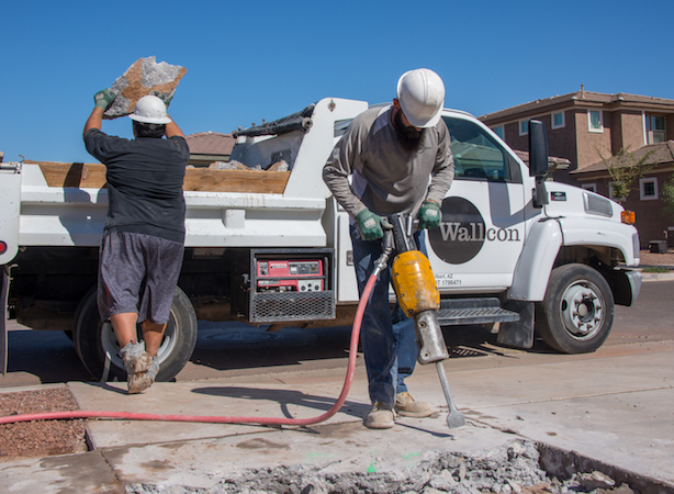 Wallcon team removing concrete together